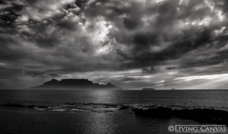 Stormy sunset over cape towns table mountain and lions head canvas print